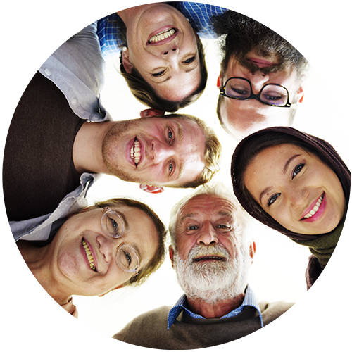 Multicultural group of men and women in a circle and smiling.